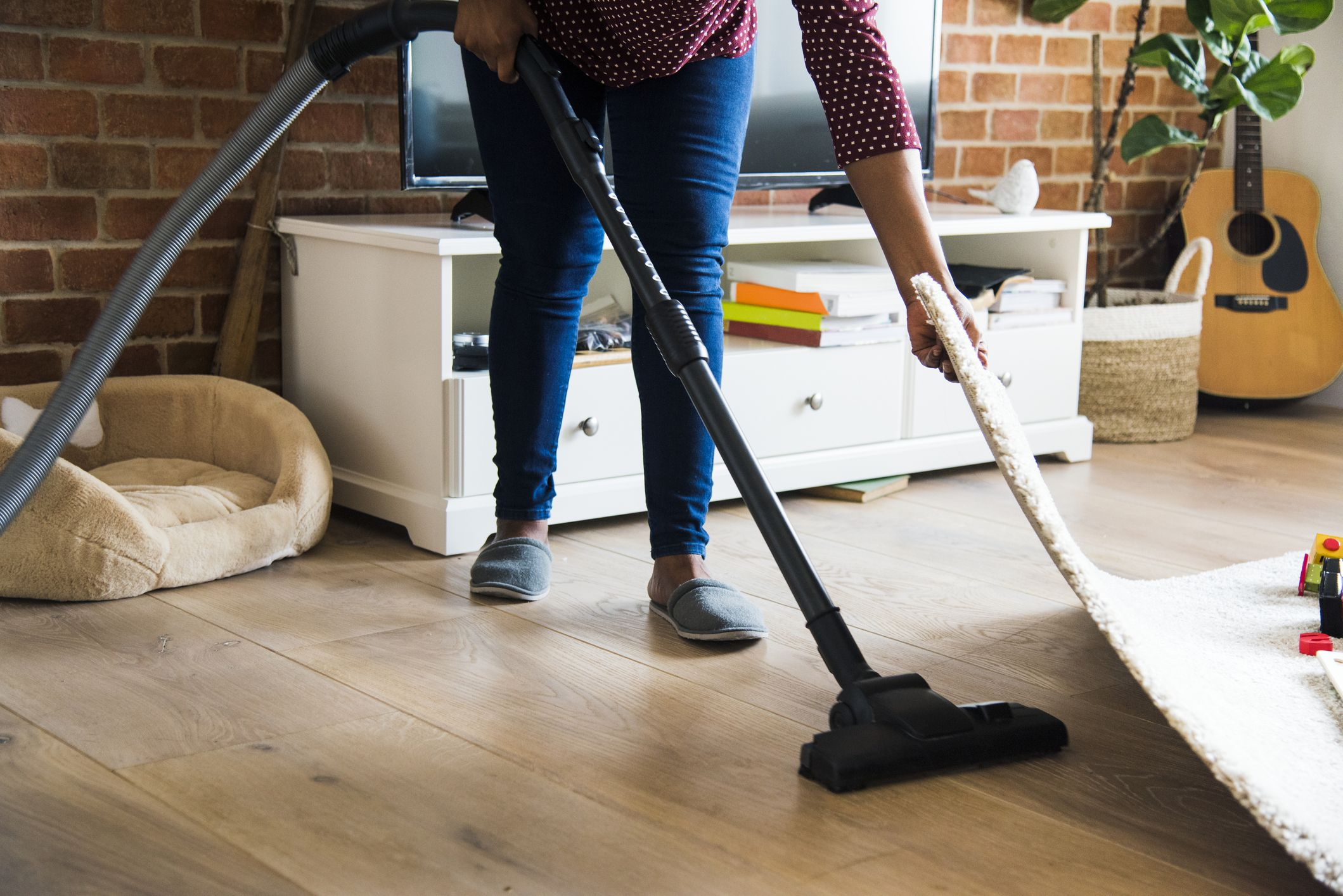 black-woman-is-cleaning-room-royalty-free-image-937992556-1565958482